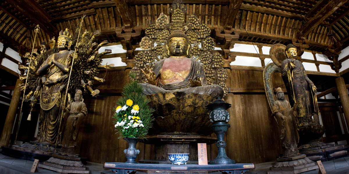 Statues of Avalokiteshvara, Shakyamuni and Gautama Buddhas in one of Tōdai-ji temple complex halls. Nara, Nara Prefecture, Kansai Region, Japan.