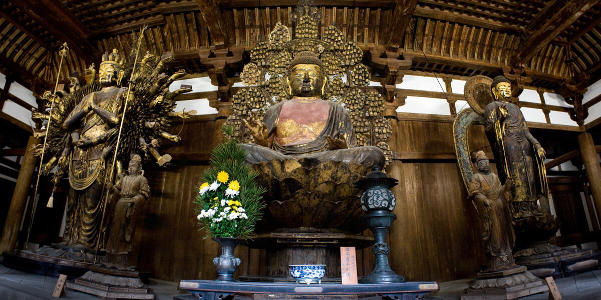 Statues of Avalokiteshvara, Shakyamuni and Gautama Buddhas in one of Tōdai-ji temple complex halls. Nara, Nara Prefecture, Kansai Region, Japan.